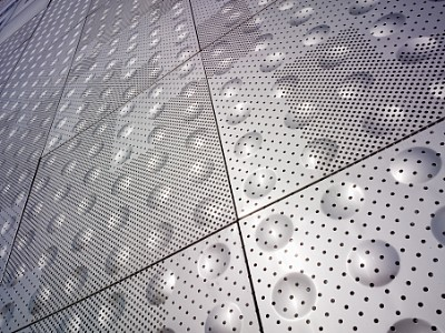 Perforated facade for Le Ruban Bleu