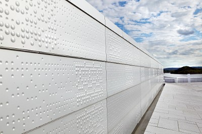 Perforated pattern of concave and convex forms from RMIG used for facade