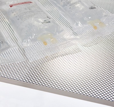 Perforated sterilizing tray