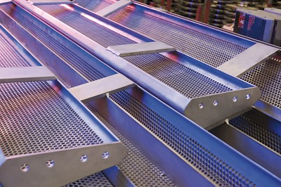 Perforated screens from RMIG used for fine channel screening escalators