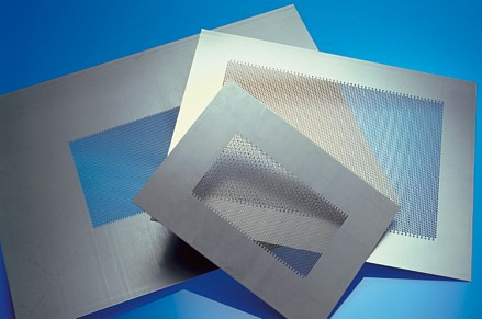 Perforated sheets for doors for microwave ovens